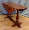Oval drop leaf tableSOLD